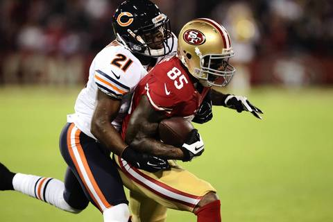 49ers tight end Vernon Davis makes a long catch in front of Major Wright in the first quarter.