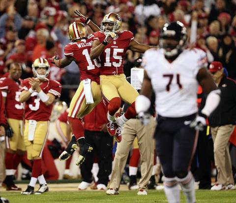 49ers wide receiver Kyle Williams and Michael Crabtree celebrate after a long pass reception by Williams in the first quarter.