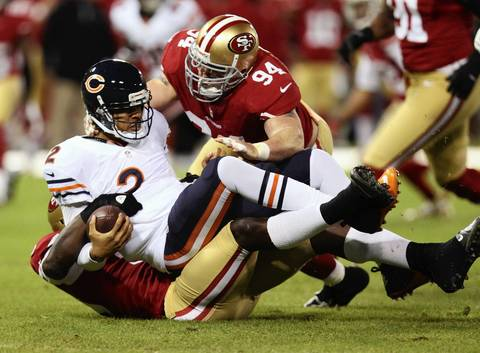 Quarterback Jason Campbell is sacked in the first quarter.
