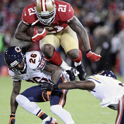 49ers' Frank Gore leaps over Tim Jennings in the second quarter.