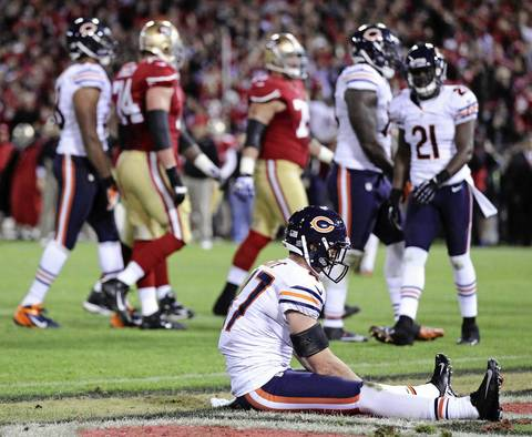 Chris Conte sits in the end zone alone after not being able to keep the 49ers' Kendall Hunter from rushing for a touchdown in the second quarter.