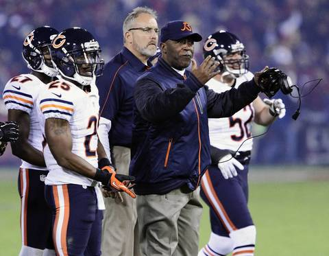 Bears coach Lovie Smith calls his players to huddle at the start of the game.