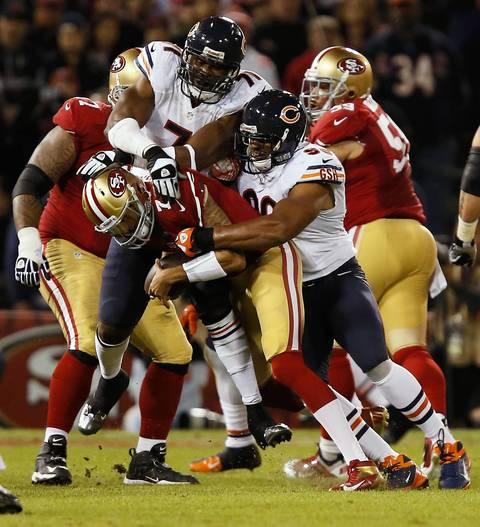 Corey Wootton and Israel Idonije sack 49ers quarterback Colin Kaepernick in the second quarter.
