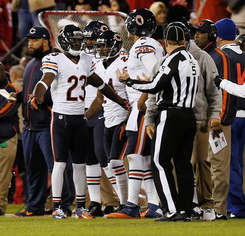 Devin Hester talks with quarterback Jason Campbell after an interception was thrown to 49ers cornerback Tarell Brown in the second quarter.