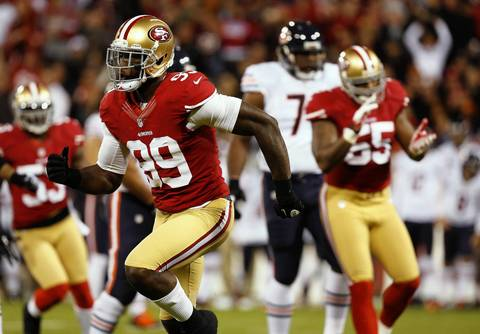 49ers linebacker Aldon Smith celebrates sacking quarterback Jason Campbell in the first quarter.