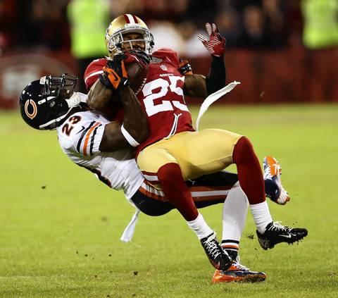 49ers cornerback Tarell Brown is tackled by Devin Hester after an interception by Brown in the second quarter.