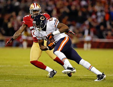 Wide receiver Alshon Jeffery runs after a reception as the 49ers' Tarell Brown covers in the first quarter.