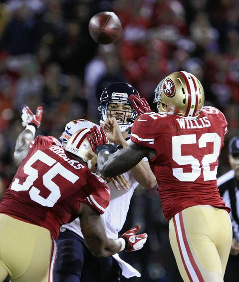 Jason Campbell tries to throw the ball through the 49ers defense in the third quarter.