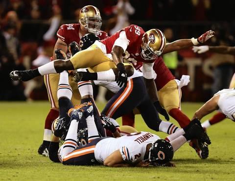 49ers linebacker Aldon Smith flies over quarterback Jason Campbell after a third quarter sack.