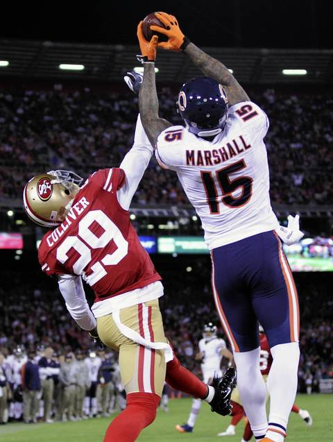 Brandon Marshall grabs the ball for a touchdown as the 49ers' Chris Culliver defends in the third quarter.