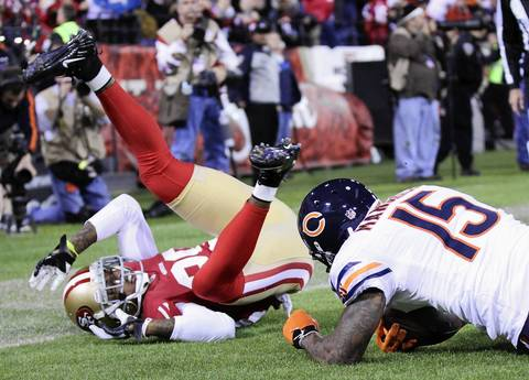 Brandon Marshall holds onto the ball for a touchdown as the 49ers' Chris Culliver flips while defending him in the third quarter.
