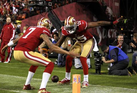 49ers wide receiver Michael Crabtree and quarterback Colin Kaepernick celebrate after a third quarter touchdown by Crabtree.