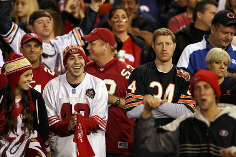 A Bears fan shows his frustration as 49ers fans celebrate in the third quarter.