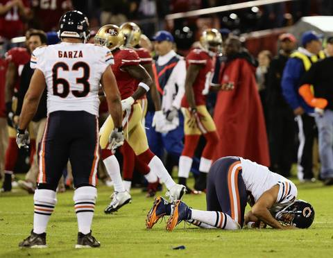 Jason Campbell lies on the ground after taking a hard hit in the third quarter.