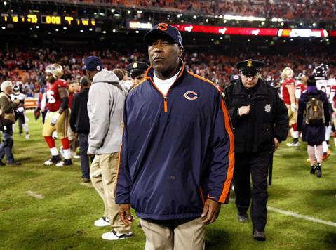 Coach Lovie Smith walks off the field after losing to the 49ers.