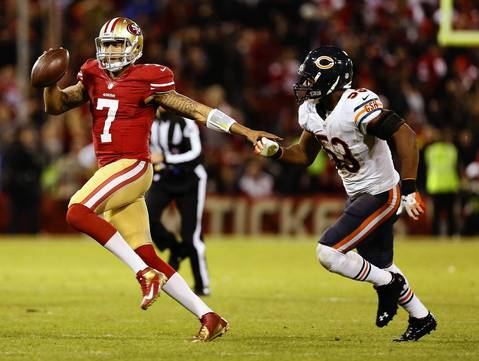 49ers quarterback Colin Kaepernick scrambles for some yards as Nick Roach chases him in the third quarter.