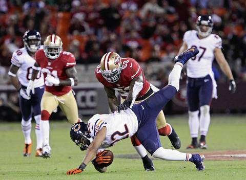 Matt Forte falls after being tackled in the fourth quarter.