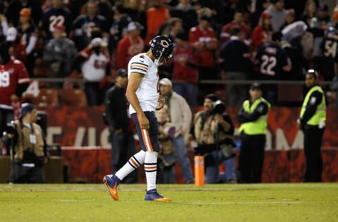 Jason Campbell walks back to the sidelines after fumbles the ball in the fourth quarter.