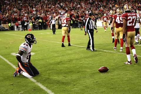 Devin Hester sits on the ground after failing to gain many yards on a return in the third quarter.