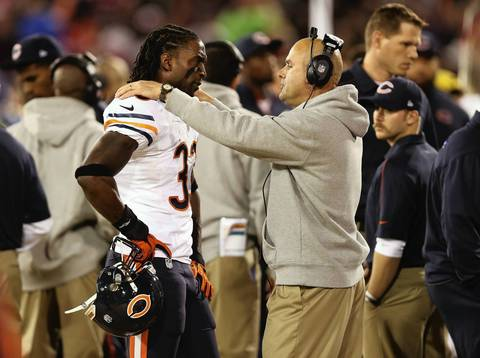Charles Tillman is attended to on the sideline in the first half.