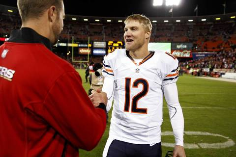 Backup quarterback Josh McCown talks with a member of the 49ers following the loss.