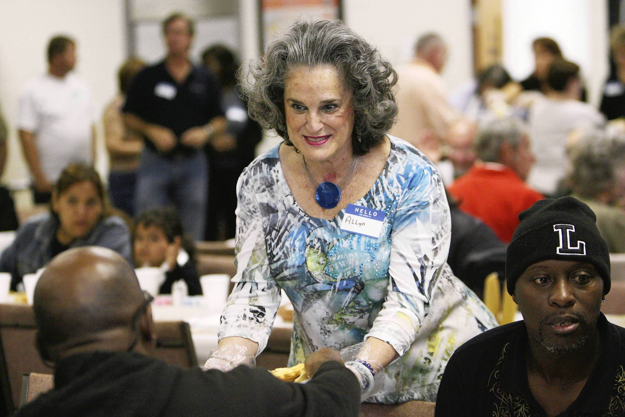 Volunteer Allyn Griffin serves guests at the 29th annual free community Thanksgiving dinner Thursday at First Baptist Church of Apopka.