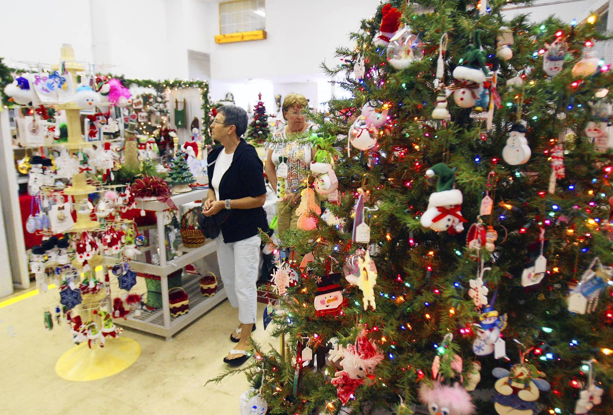 Early birds do Christmas shopping at the Main Street Christmas House on Friday, November 16, 2012. The annual event features more than 50,000 handcrafted holiday decorations and gifts by more than 100 craftsmen and women. The Christmas House opened Nov. 1 and will remain open until Dec. 15.  (Tom Benitez/Orlando Sentinel)