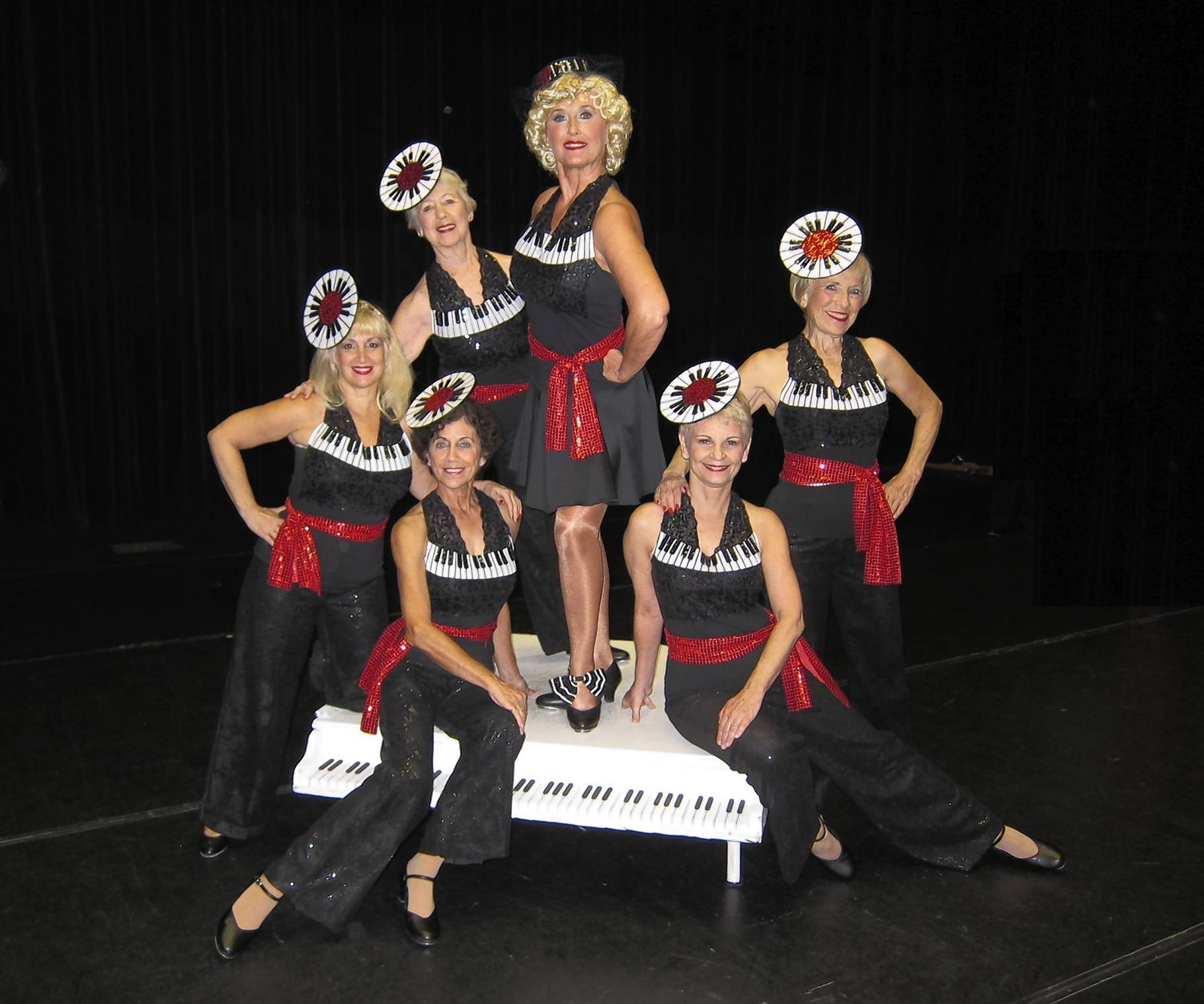 "Cast members of Villages production of ""White Christmas,"" seated from left, Rosie Theiss and  Bonnie Felicicchia; standing from left, Angela Ferrigamo, Marge Blakely, Linda Berthiaume and Diane Arduin."