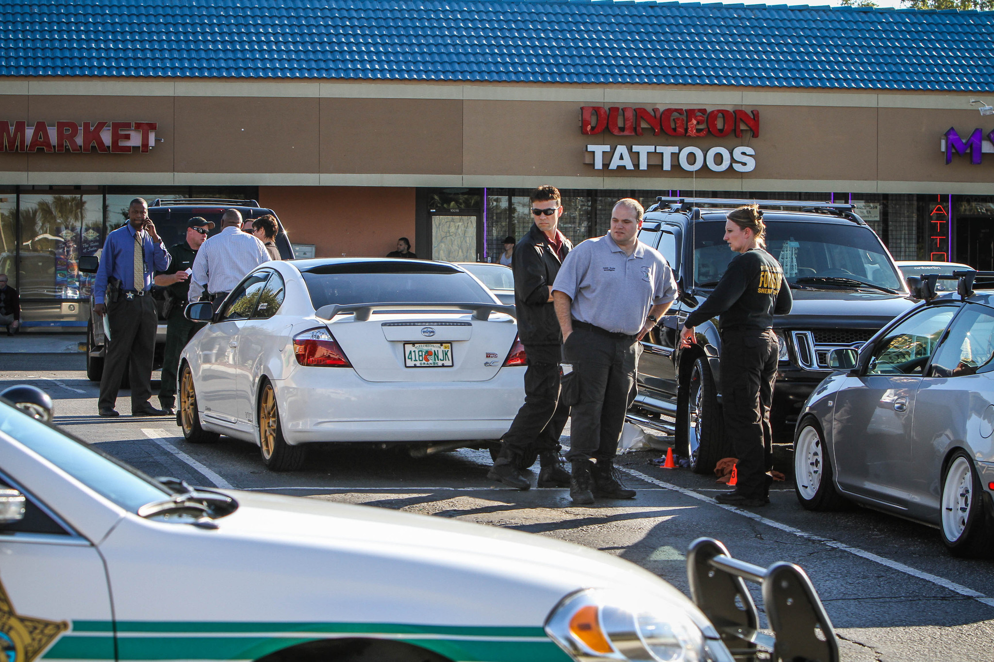 The Orange County Sheriff's office investigates a shooting at the University Oaks Shopping Plaza in Orlando, Fla. on Friday, November 23, 2012.