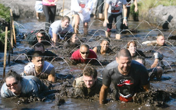 "Competitors participate in the ""Run for Your Lives"" Zombie-infested obstacle course 5K in Clermont, Florida on Saturday, November 17, 2012. (Cassie Armstrong, Orlando Sentinel)"