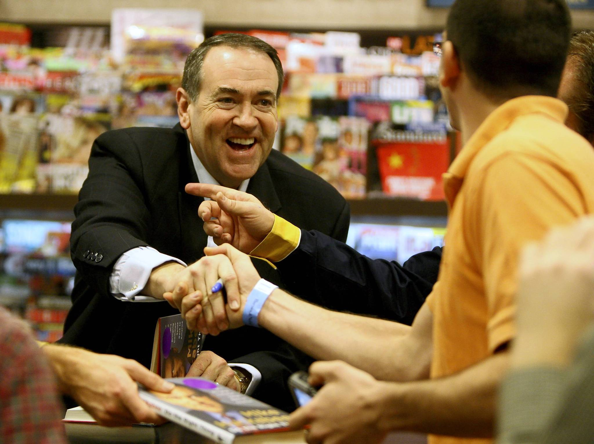 Mike Huckabee greets a fan during his book signing at the Barnes &amp; Noble at Colonial Plaza in Orlando on Dec. 8, 2008.