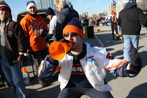 Ryan Lesak of Palos Park, Ill. uses a megaphone while tailgating before the start of the Chicago Bears game against the Minnesota Vikings at Soldier Field in Chicago on Sunday.