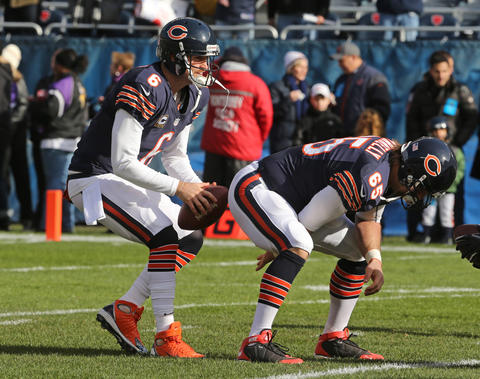 Chicago Bears quarterback Jay Cutler (6) takes a snap from Chicago Bears long snapper Patrick Mannelly (65) during pre-game warm-ups before the start of the game against the Minnesota Vikings at Soldier Field in Chicago Sunday.