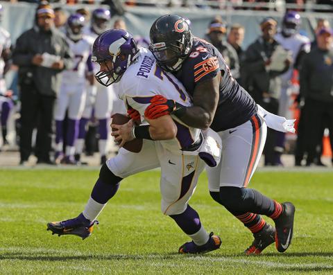 Defensive tackle Henry Melton sacks Vikings quarterback Christian Ponder during the first half.