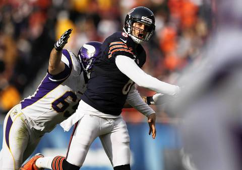 Jay Cutler throws a touchdown pass as the Vikings' Jared Allen moves in during the 2nd quarter.