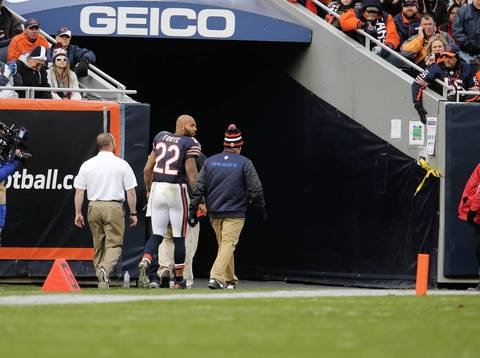 Running back Matt Forte heads to the locker room after getting injured during the second half.