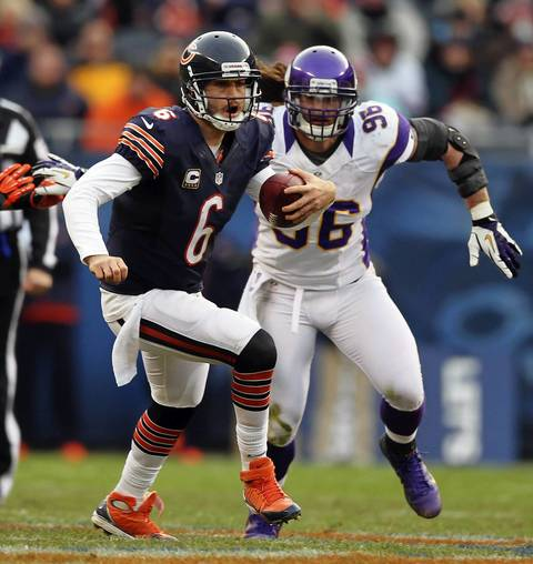 Jay Cutler scrambles as the Vikings' Brian Robinson chases during the 4th quarter.