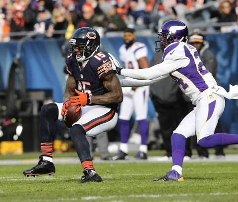 Brandon Marshall catches a pass in front of Vikings cornerback A.J. Jefferson during the first half.
