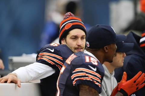 Jay Cutler on the bench with Brandon Marshall during the final minutes of their game.