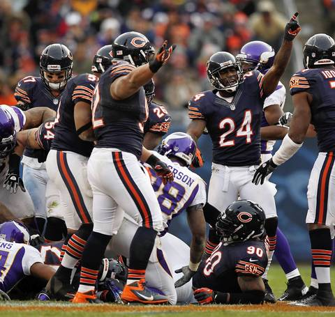 Kelvin Hayden signals recovery of fumble by the Vikings' Adrian Peterson in the 4th quarter.