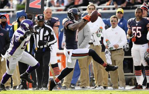 Brandon Marshall high steps down the sidelines after a 1st quarter reception.