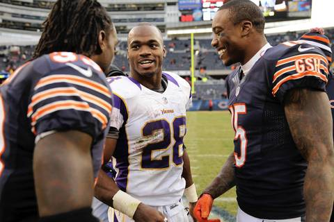Brandon Marshall and Charles Tillman greet the Vikings' Adrian Peterson after the Bears' 28-10 win.