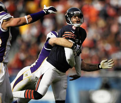 Jay Cutler is hit after throwing touchdown pass to Matt Spaeth in the 2nd quarter.