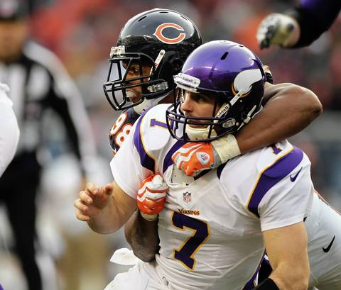 Corey Wootton and Vikings QB Christian Ponder watch a pass during the 4th quarter.