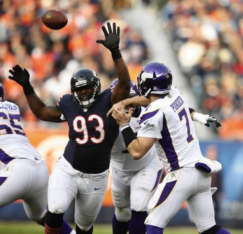 Vikings quarterback Christian Ponder throws a pas while being pressured by Nate Collins during the second half.