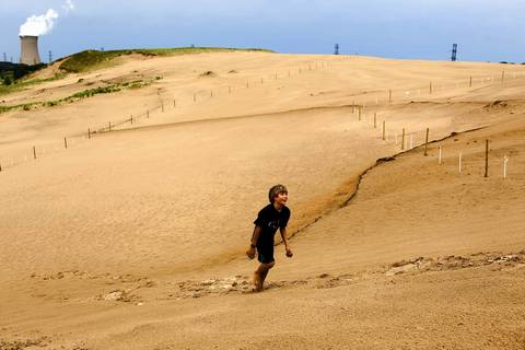 Erik Beyer, 10, of Cary, N.C., climbs to the summit of Mt. Baldy, part of the Indiana Dunes National Lakeshore. Mt. Baldy is located two miles from the 11th Street South Shore Line train station in Michigan City.