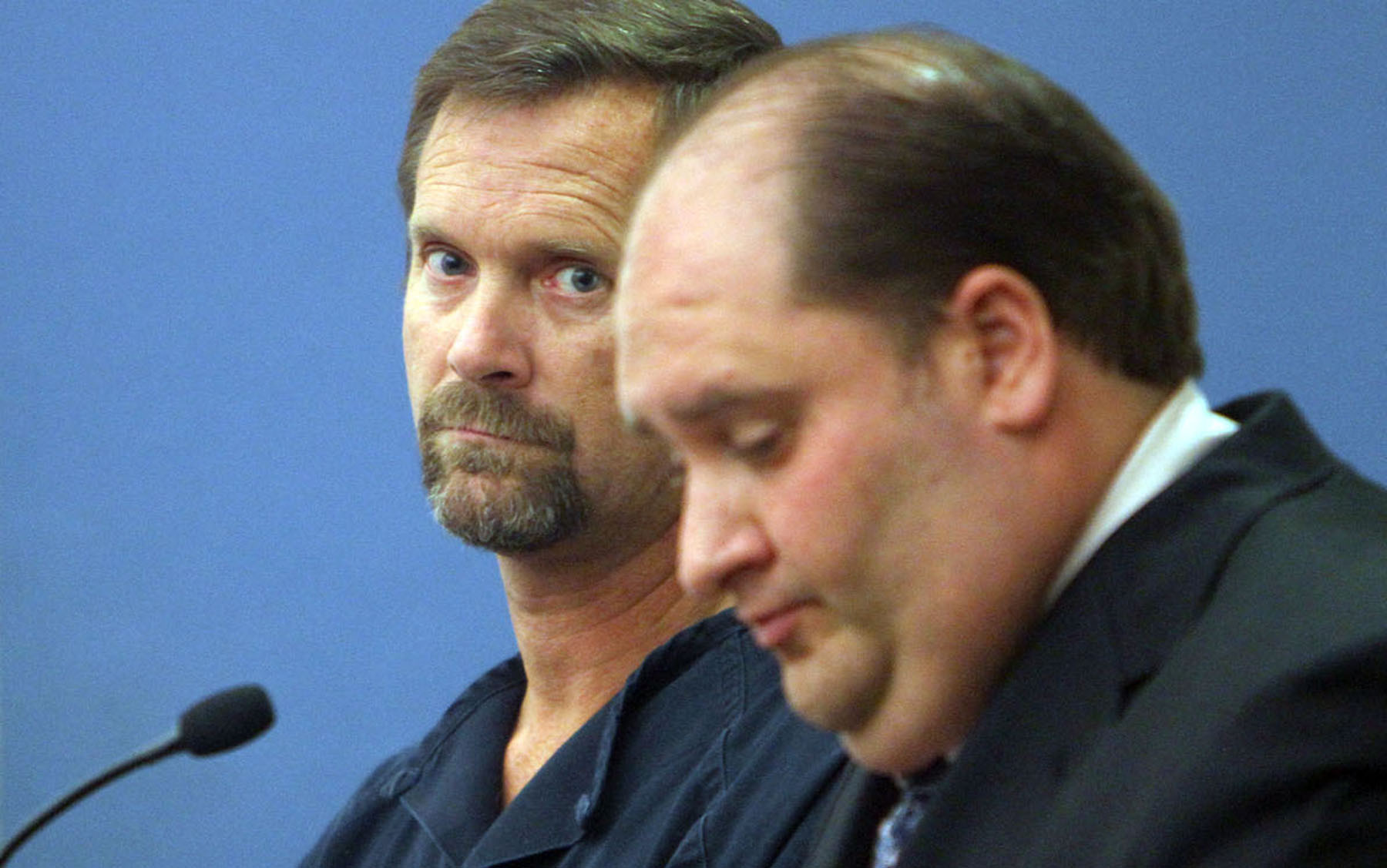 Danny Sidders,left,a suspended Orlando police officer attends hearing at Orange County Jail.Sidders is accused of beating girlfriend.