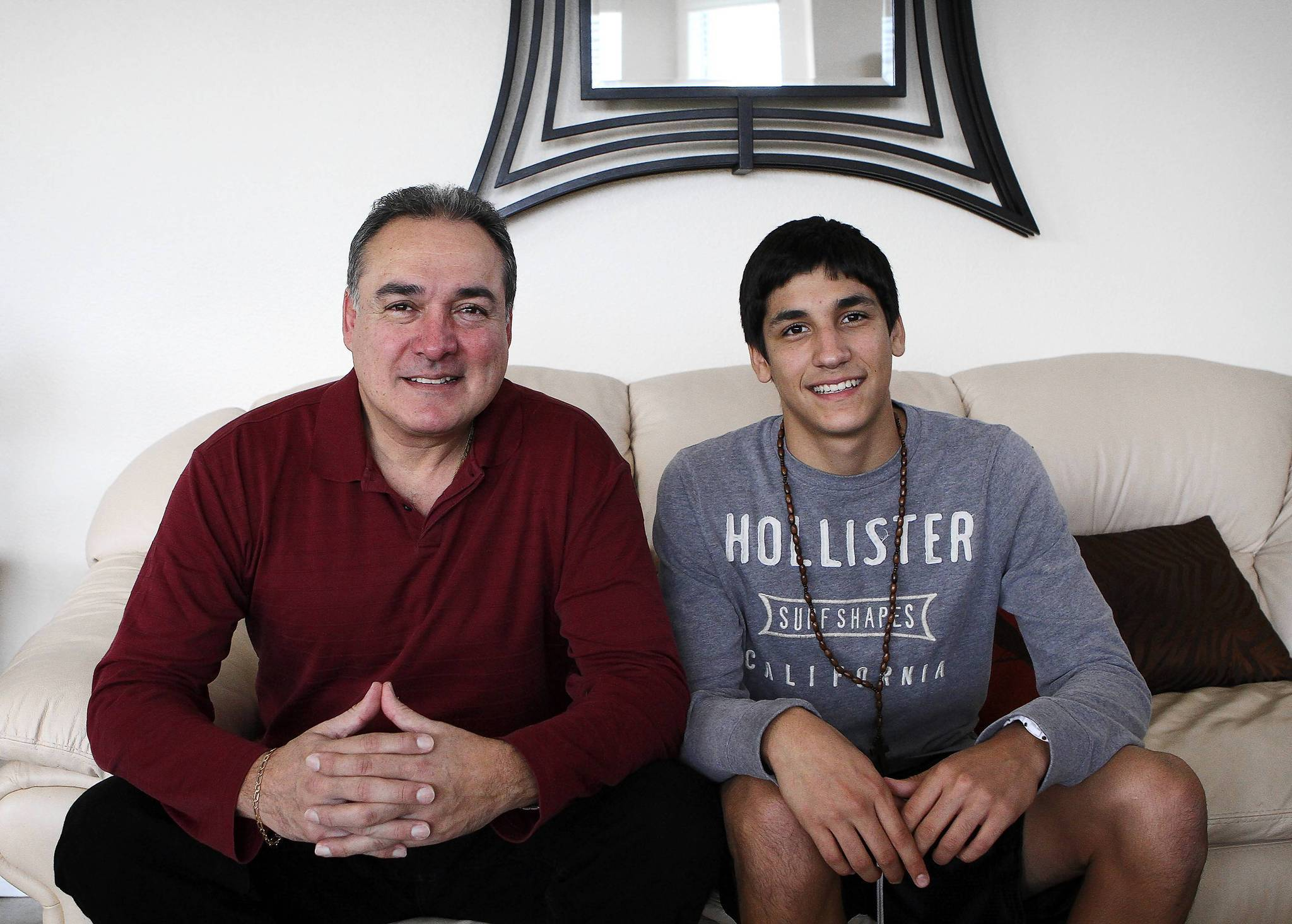 Armando Calle, left, and his son Jesus Calle, 15, at their Orlando home on November 20, 2012. Jesus and his sister Monique will be among the 161,000 American-born Hispanics in Metro Orlando who will contribute to the doubling of the Hispanic electorate in the U.S.
