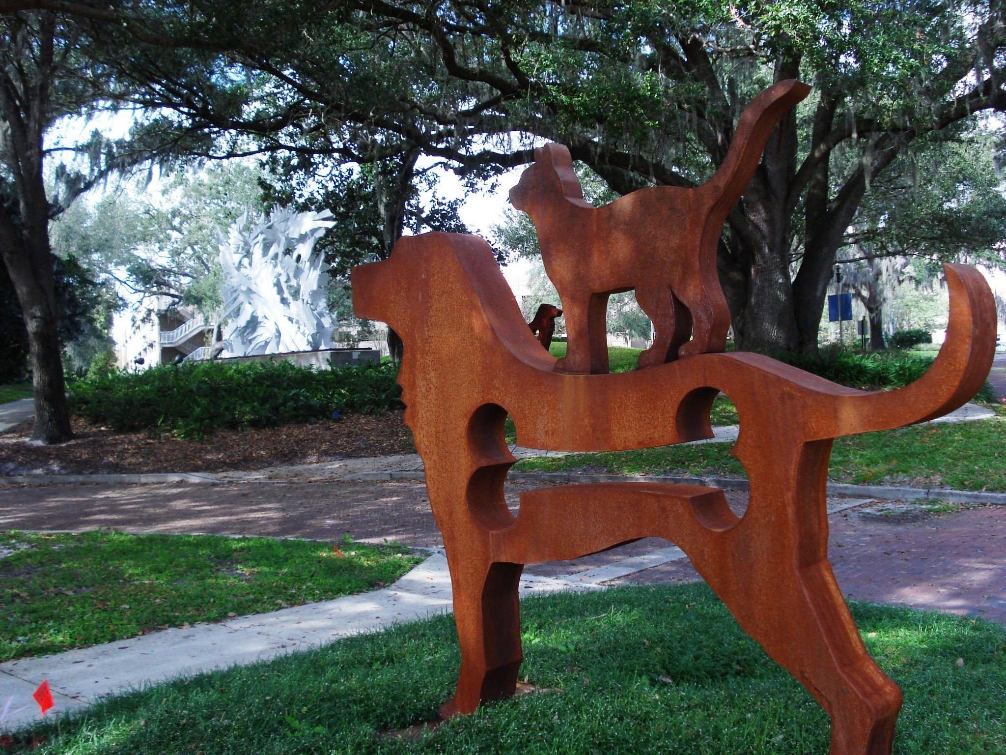A cat stowed away on this Dale Rogers sculpture at the Mennello, part of the Big Dog Show.