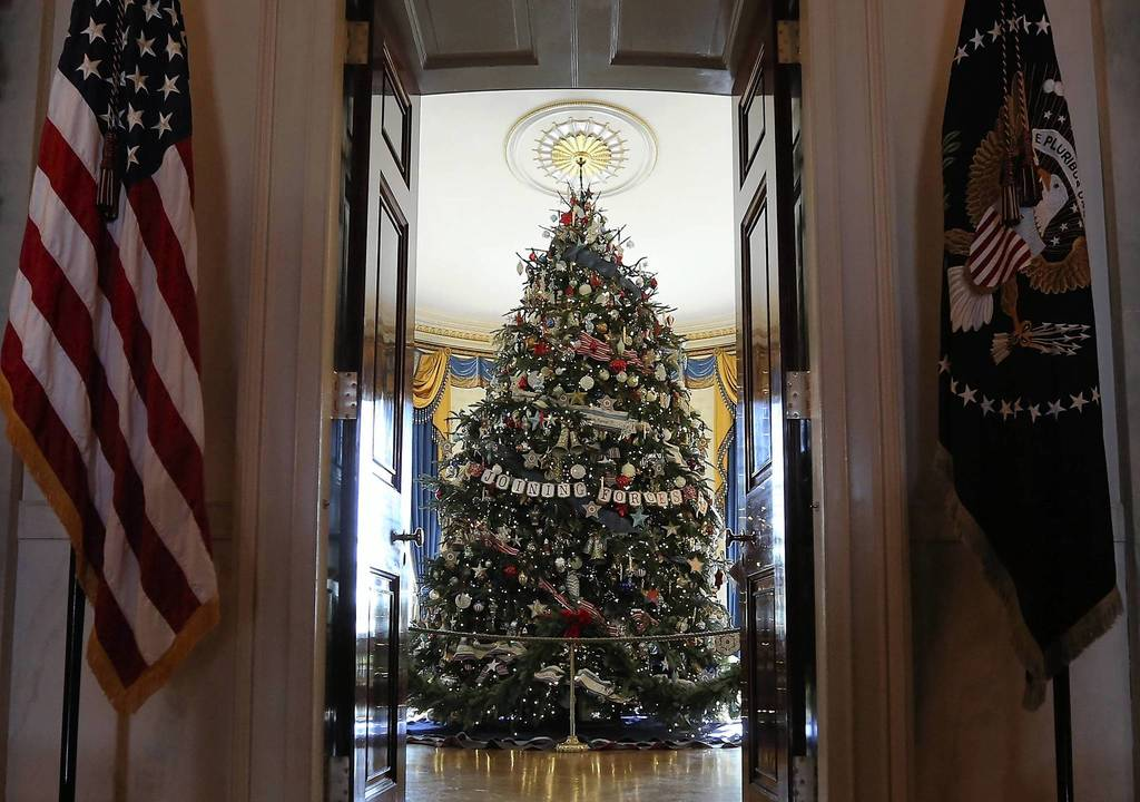 The official White House Christmas tree, an 18-foot-6-inch Fraser Fir from Jefferson, North Carolina, stands in the Blue Room during a preview of the 2012 White House holiday decorations in Washington, DC.